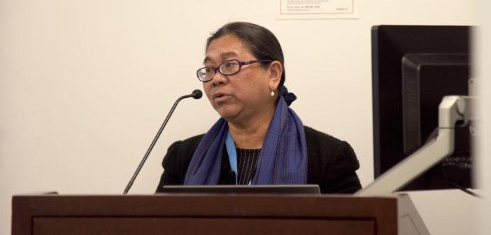 Cecilia Jimenez-Damary addresses her audience at the podium.