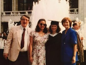 Four people standing in front of a fountain at Lincoln Center.