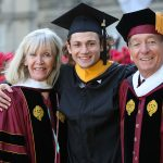 Board chair Bob Daleo and his wife, Linda, flanking their nephew how graduated