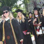 grads in sunglasses in line
